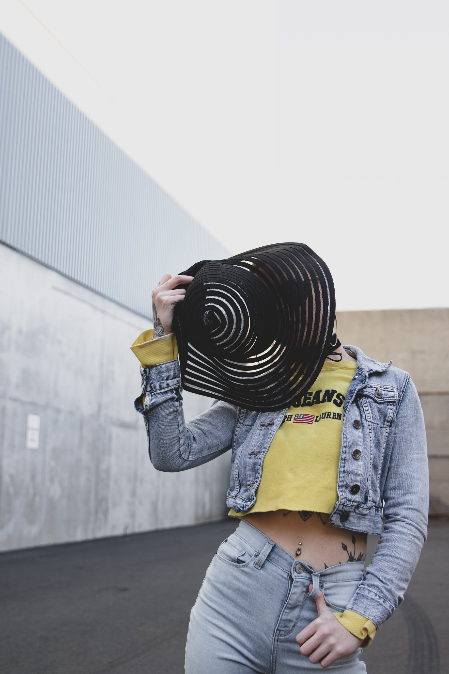 Woman Covering Her Face With Black Sun Hat