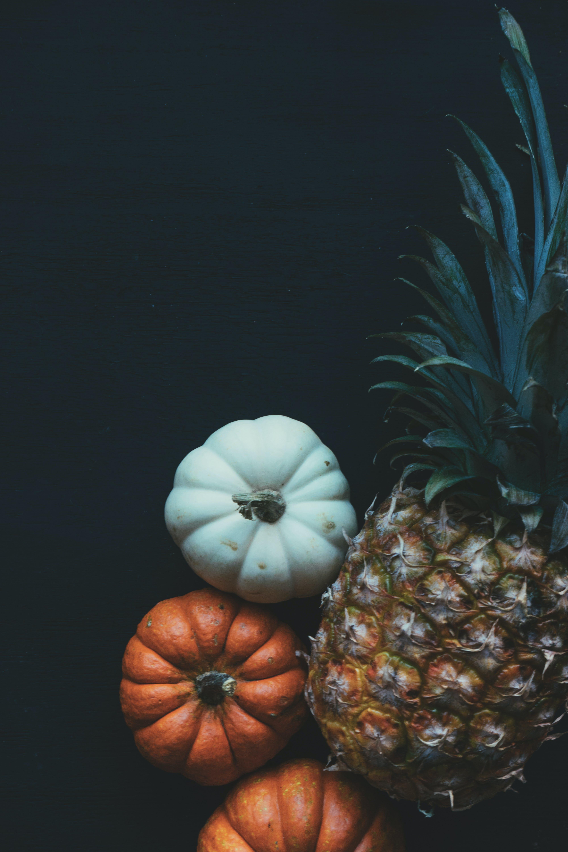 Pineapple Beside Pumpkin