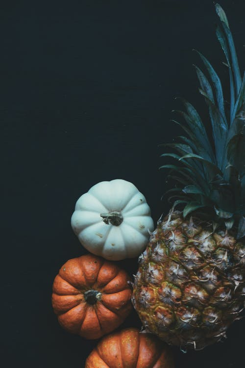 Pineapple Beside Pumpkin