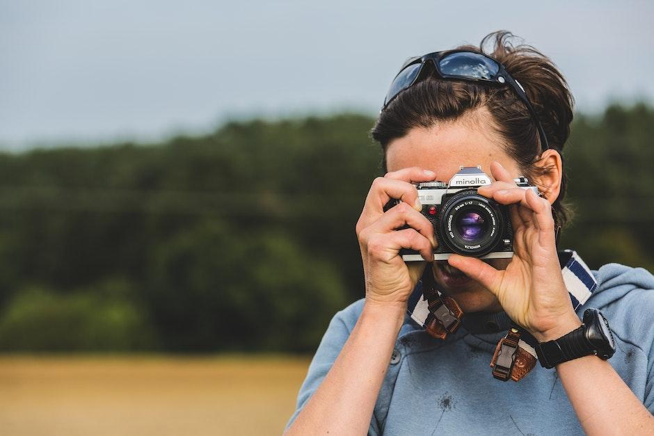 Man Holding Gray and Black Dslr Camera