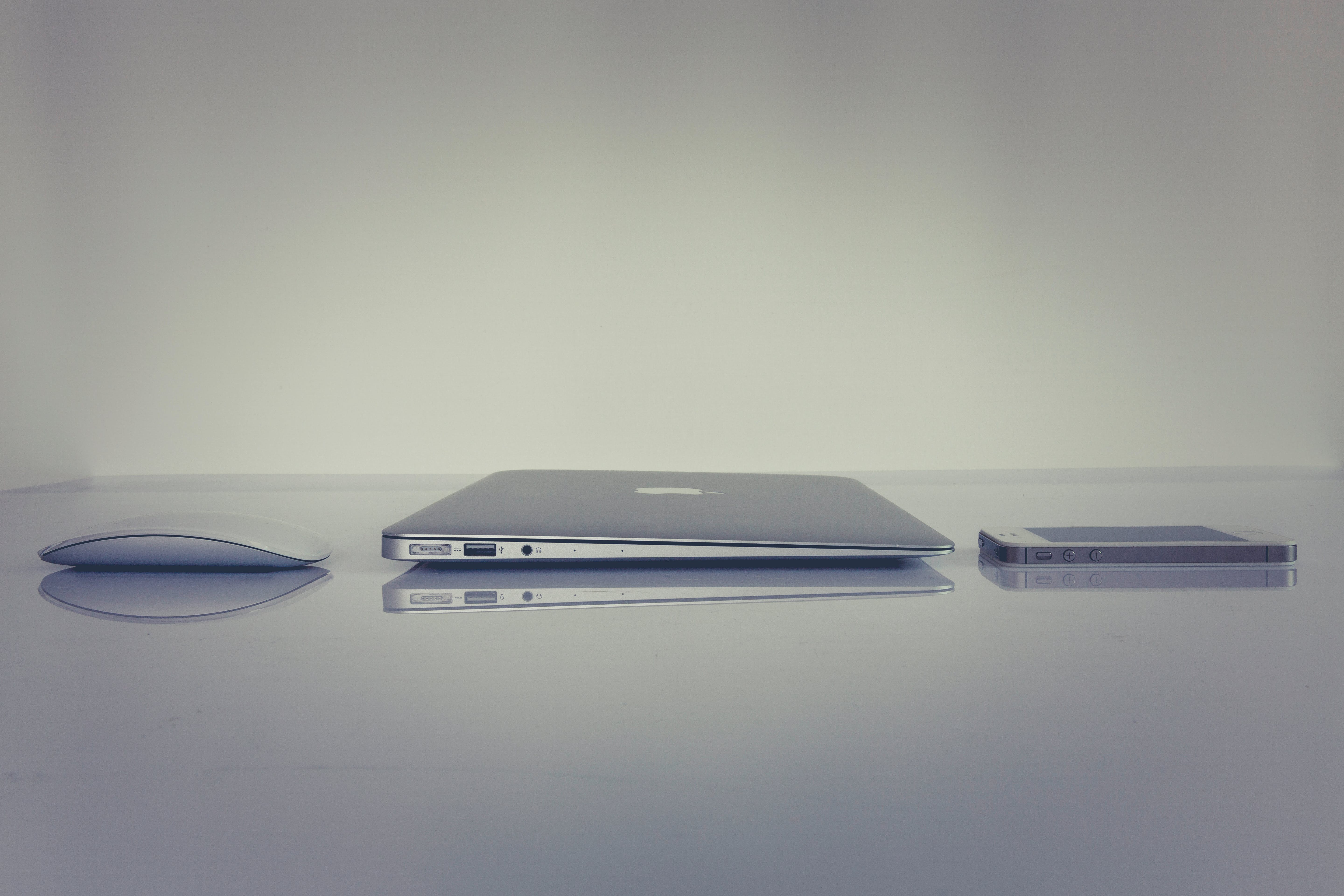 Silver Magic Mouse Beside Macbook