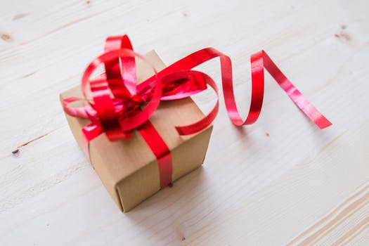 Inspiring and beautiful gift photos pexels free stock photos red ribbon on brown cardboard box negle