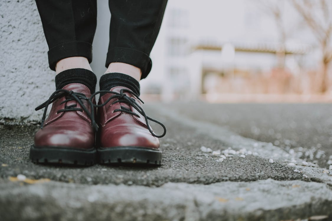 Person Wearing Leather Shoes