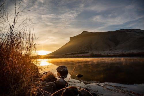 Photos gratuites de aube, coucher de soleil, crépuscule, étendue d'eau