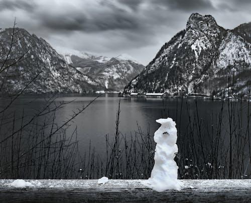 Photos gratuites de autriche, bonhomme de neige, debout, fondre
