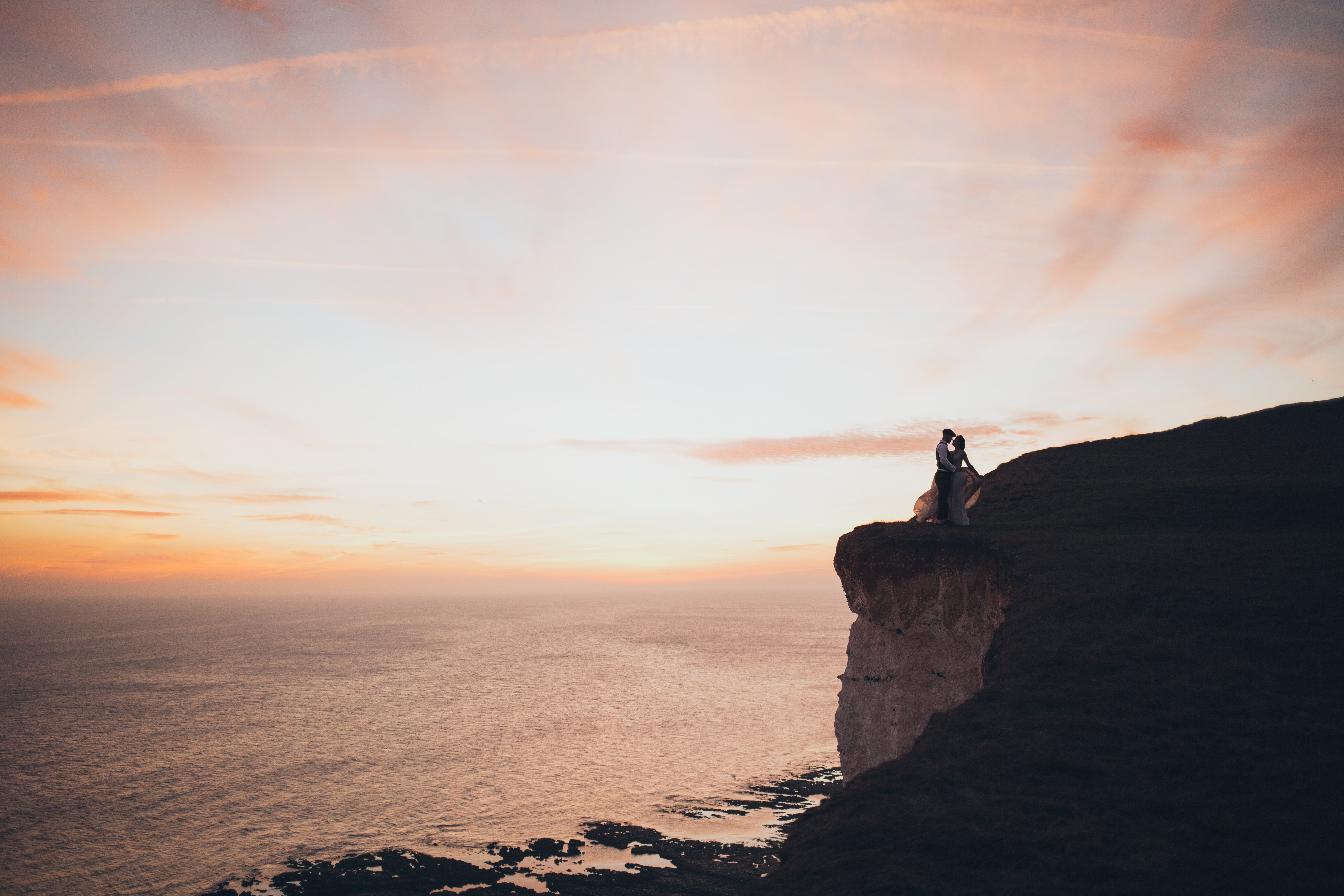Couple Standing By The Cliff