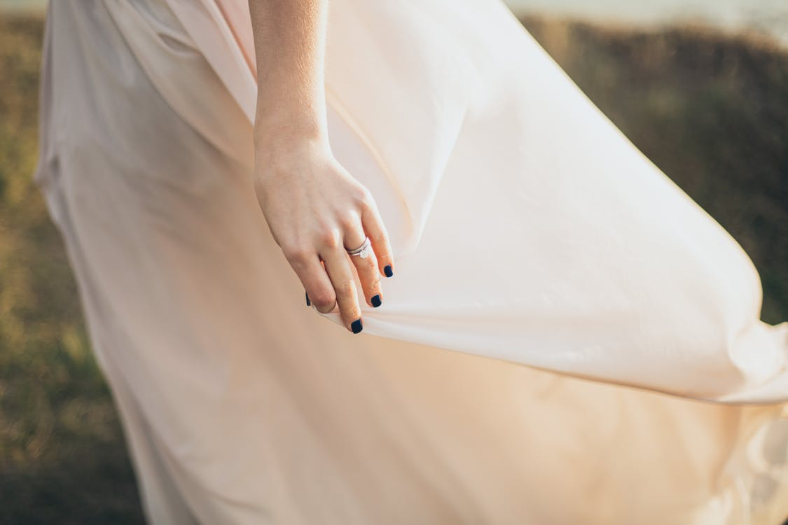 Woman Wearing White Dress With Black Manicure