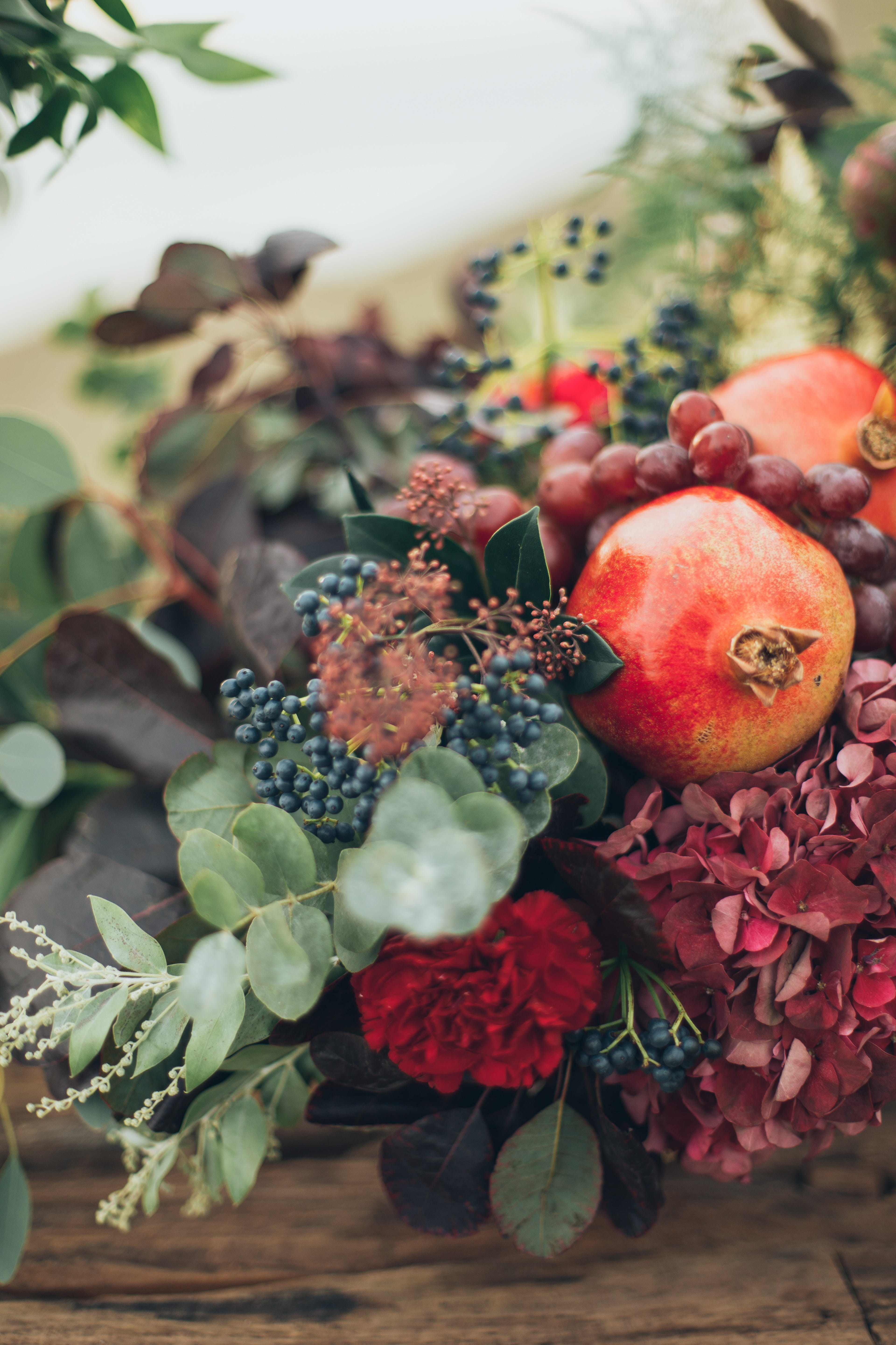 Flowers and Fruits on Wooden Surface