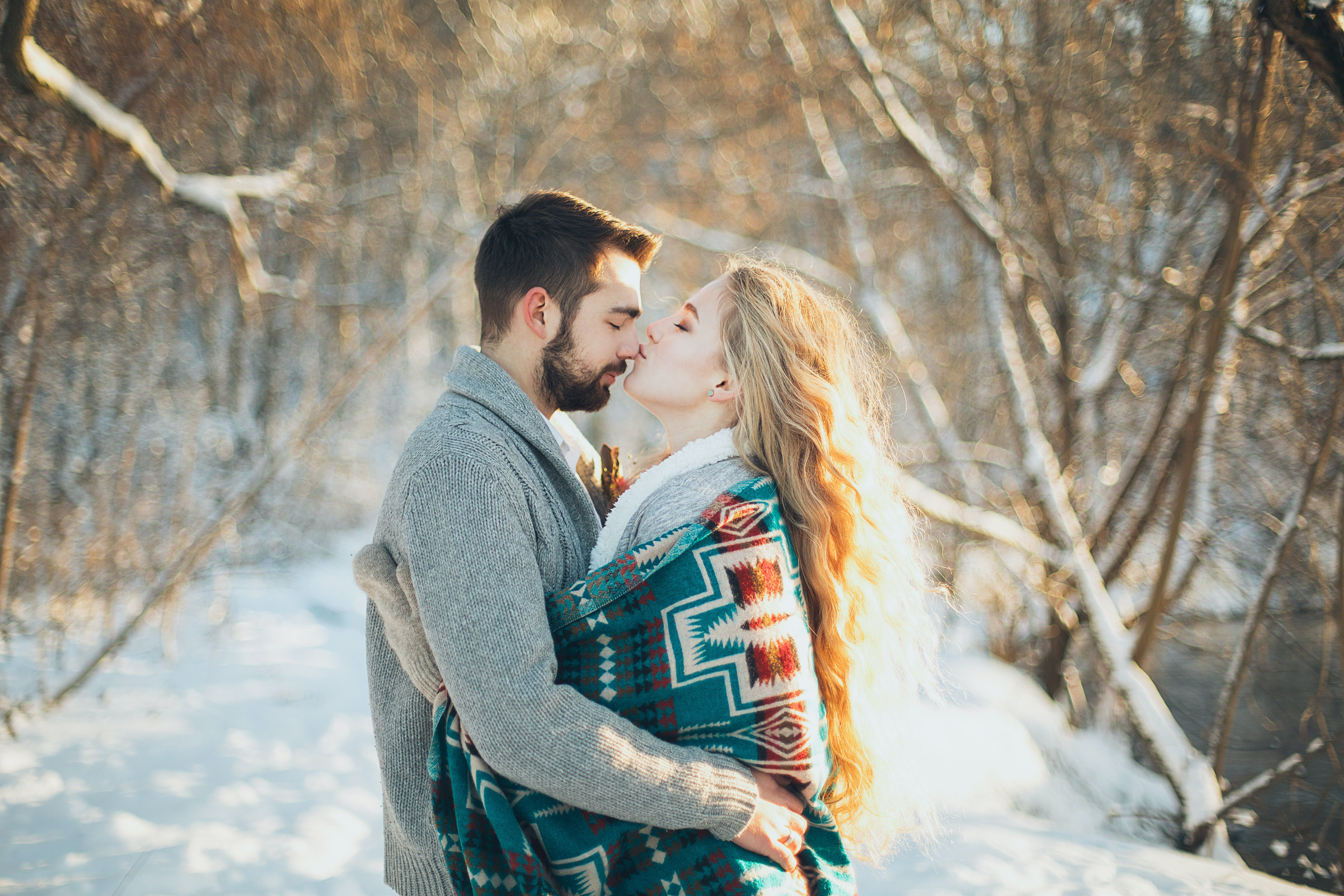 Man and Woman Hugging Each Other About to Kiss during Snow Season