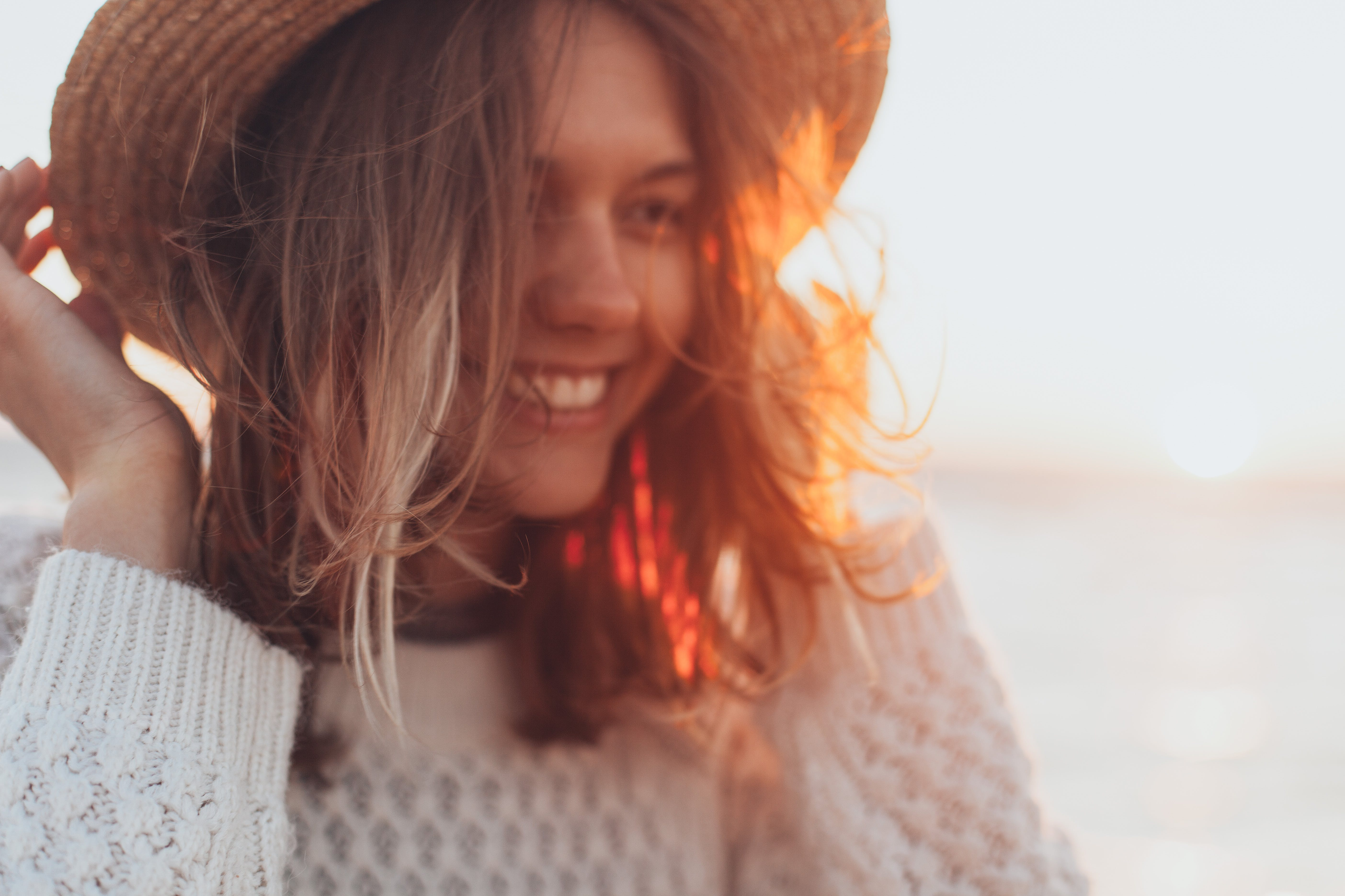Selective Focus Photo of Woman Wearing White Sweater