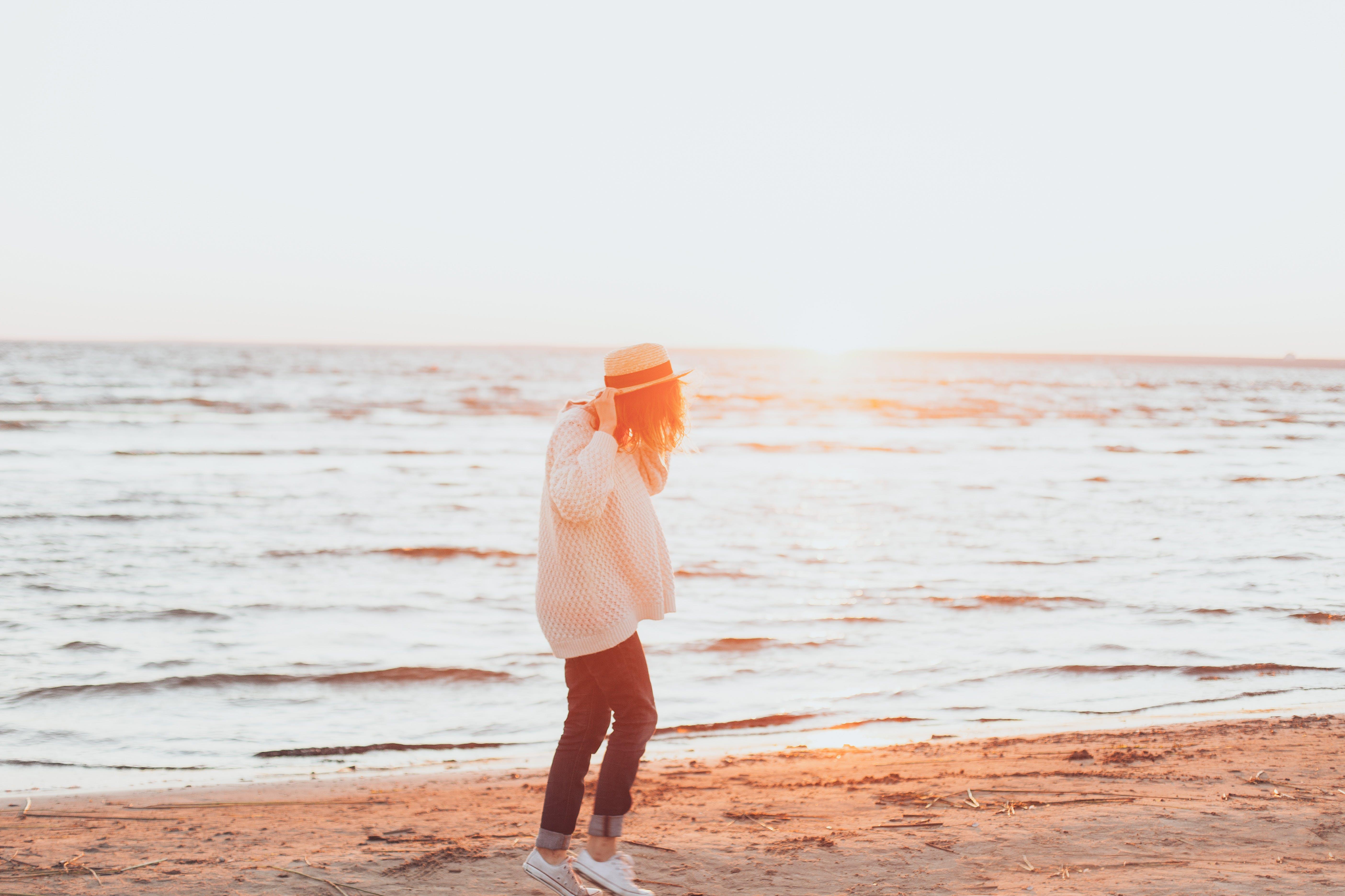 Photo of Woman Wearing White Sweater