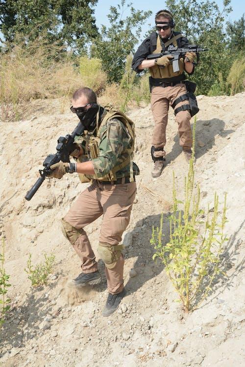 Gratis stockfoto met airsoft, geweer, handschoenen