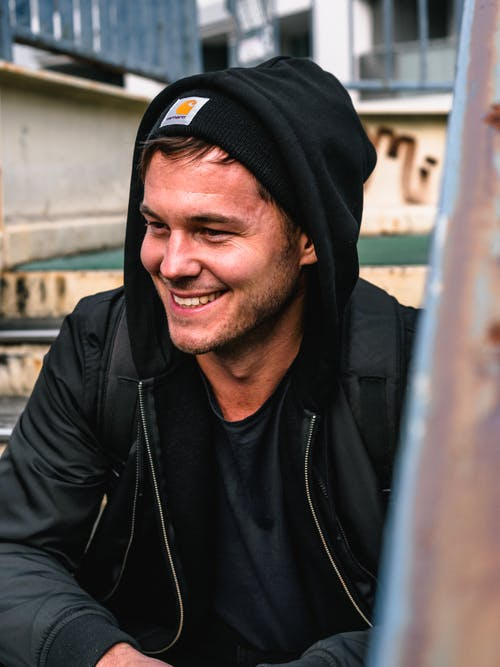 Photo of Man Smiling and Wearing Hoodie