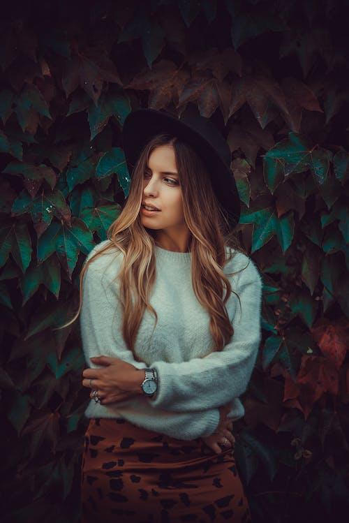 Woman in Teal Sweatshirt Crossing Arms