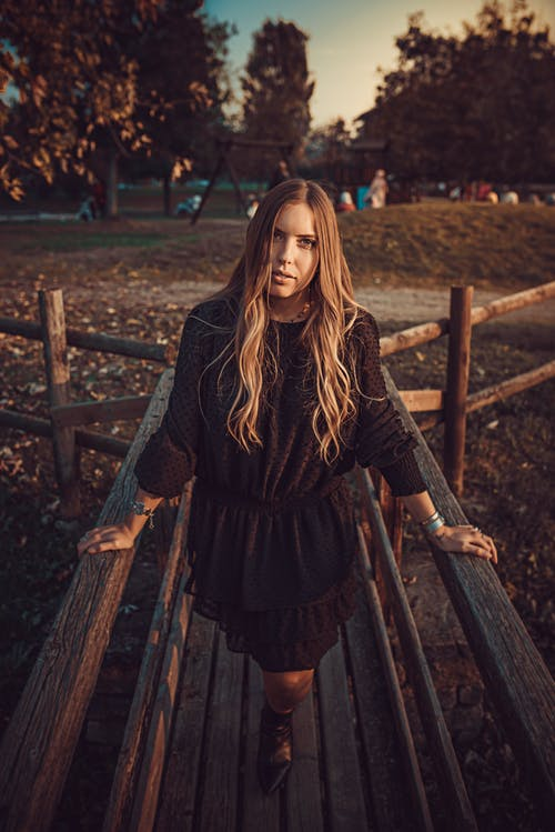 Free stock photo of black dress, blonde hair, boots, bridge