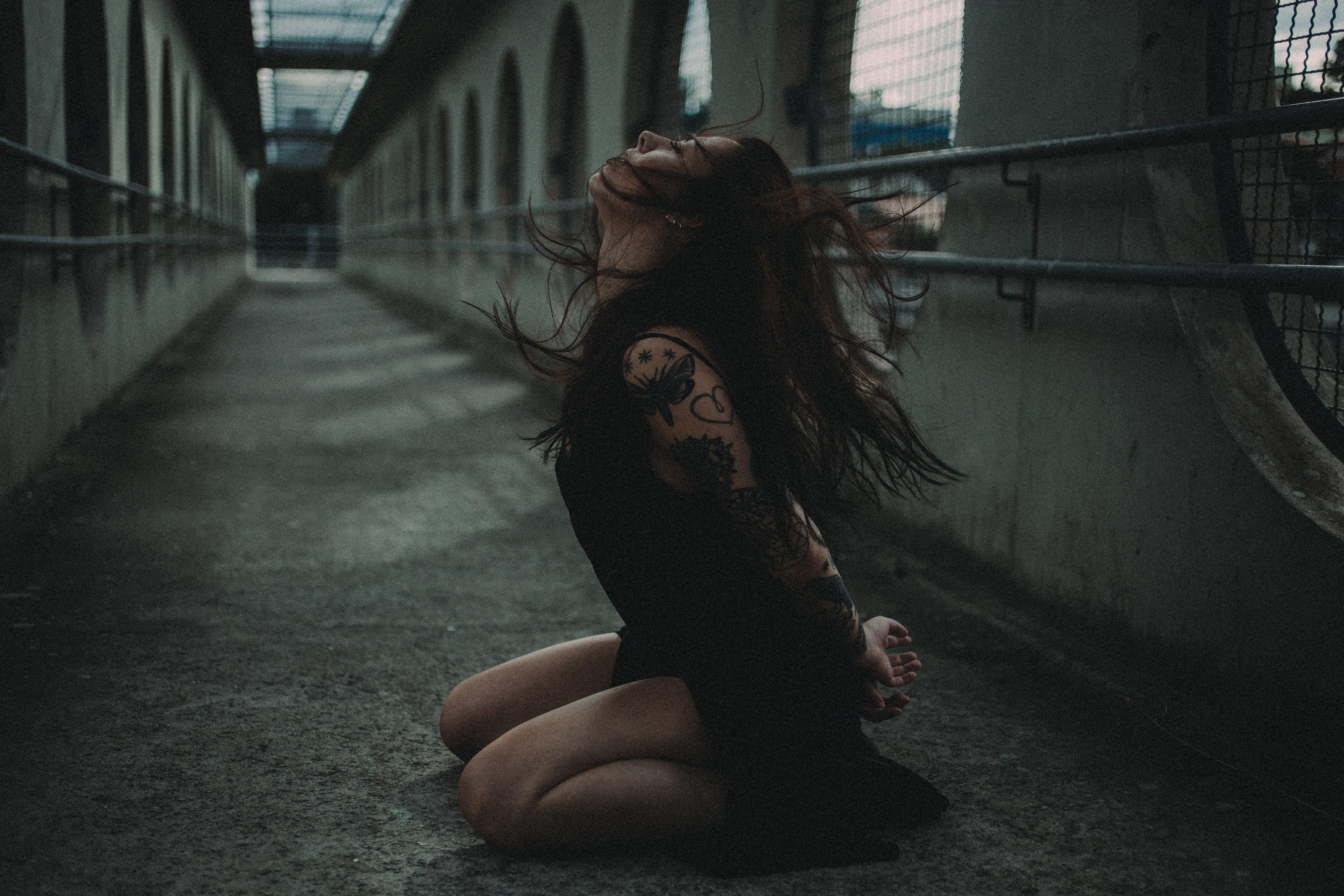 Woman Kneeling Down