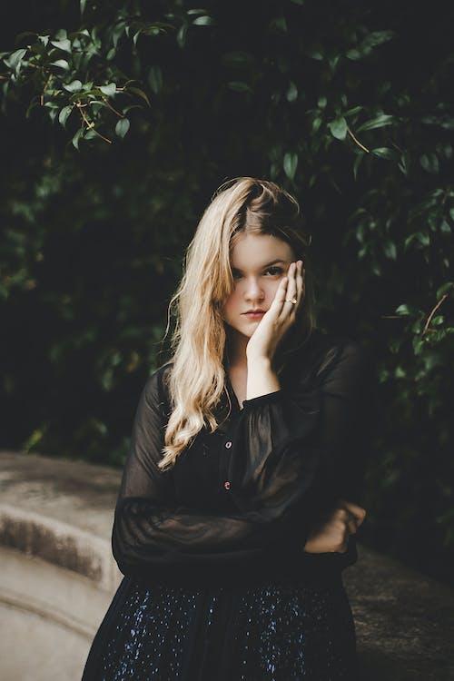 Woman Holding Left Cheek Photography