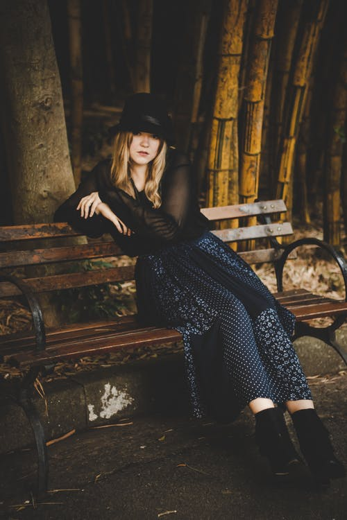 Woman Sitting on Bench Outdoor