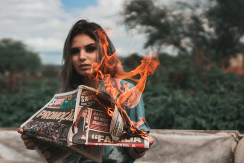 Woman Burning Newspaper