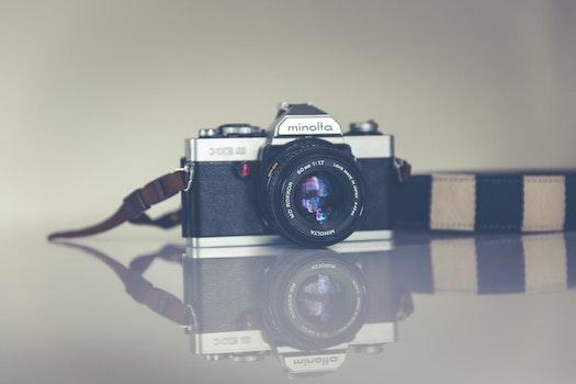 Silver and Black Minolta Camera