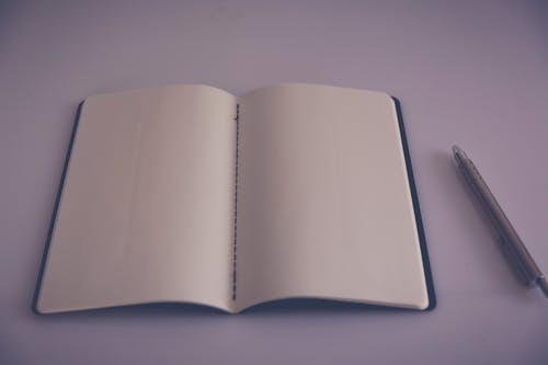 Free stock photo of ballpen, blank page, book, close-up