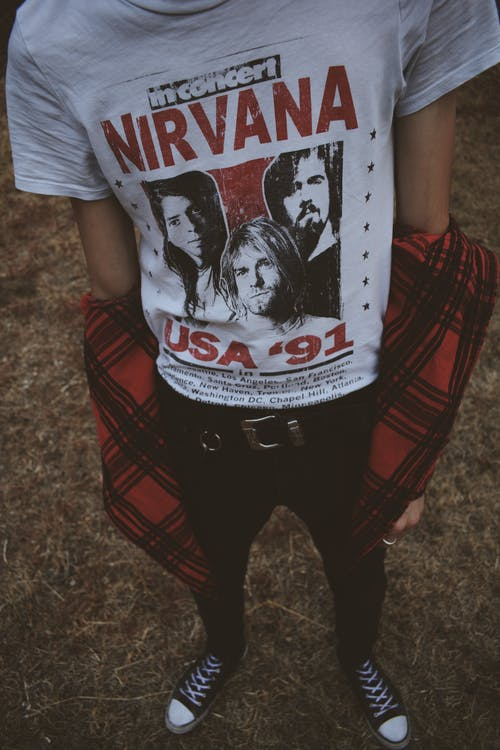 Person Wearing White and Red Nirvana Top