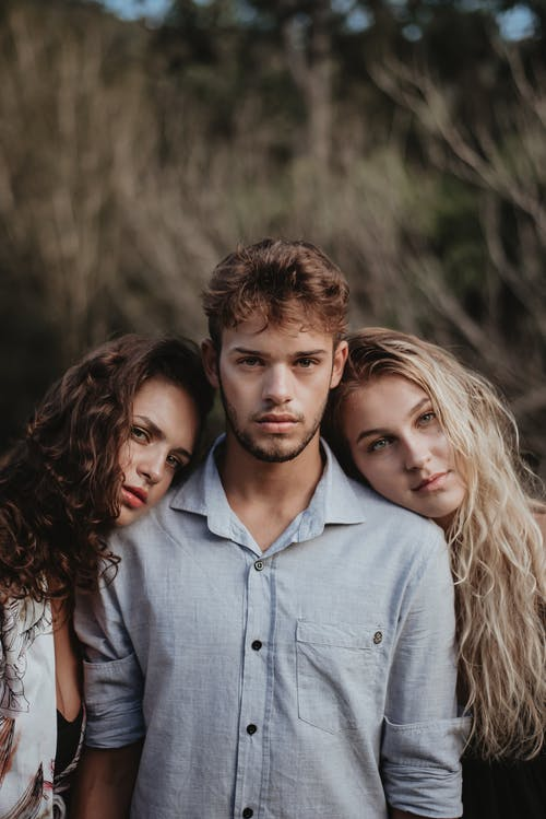 Photo of Women Leaning On A Man