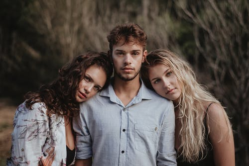 Photo of Women Leaning On A Guy
