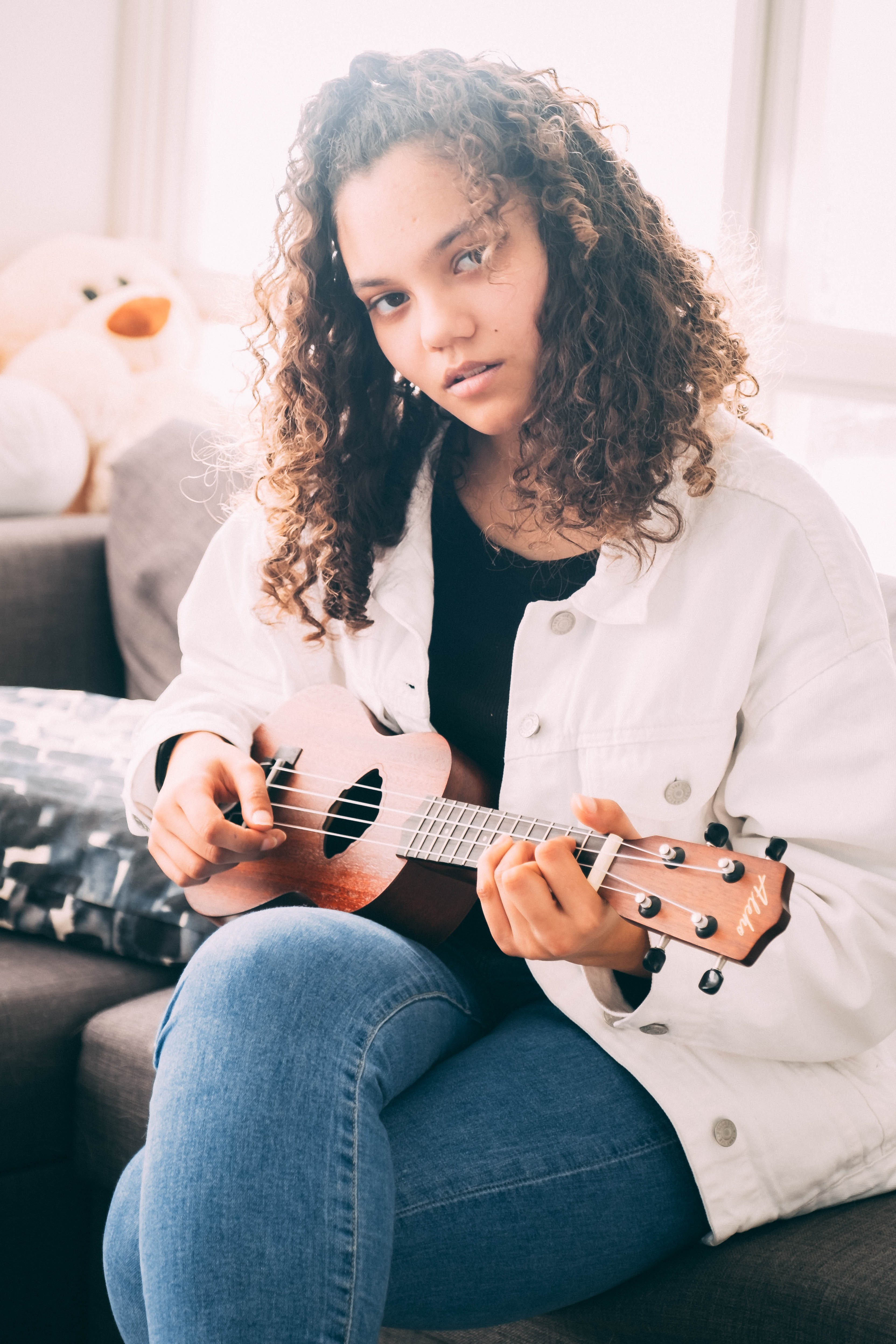 Free stock photo of curly, curly hair, girl, guitar strings