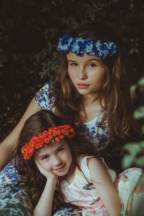 Girls Wearing Blue and Red Flower Headbands