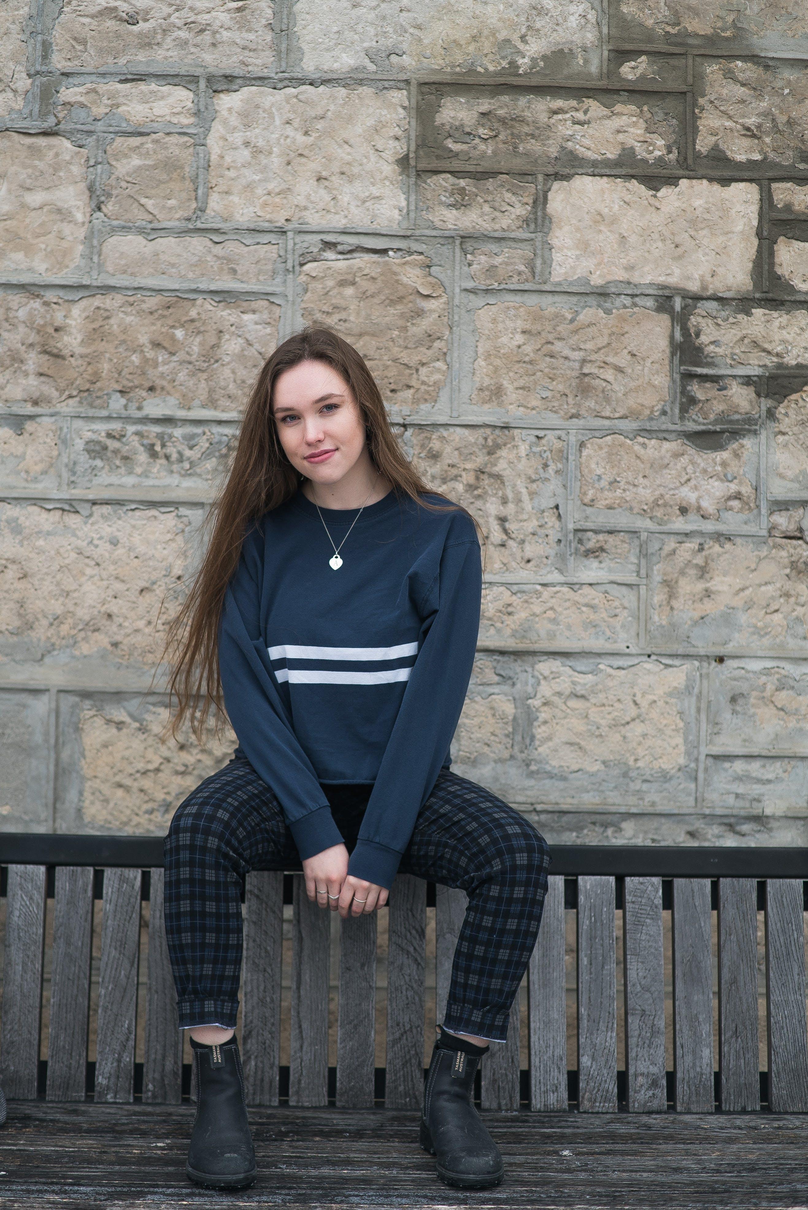 Girl Wearing Blue Sweater Sitting On Bench
