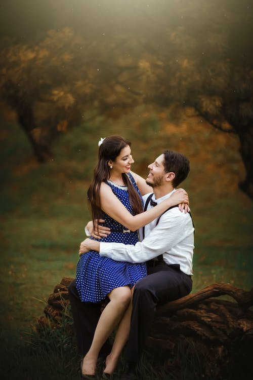 Girl Wearing Blue Dress Sitting On Man's Lap
