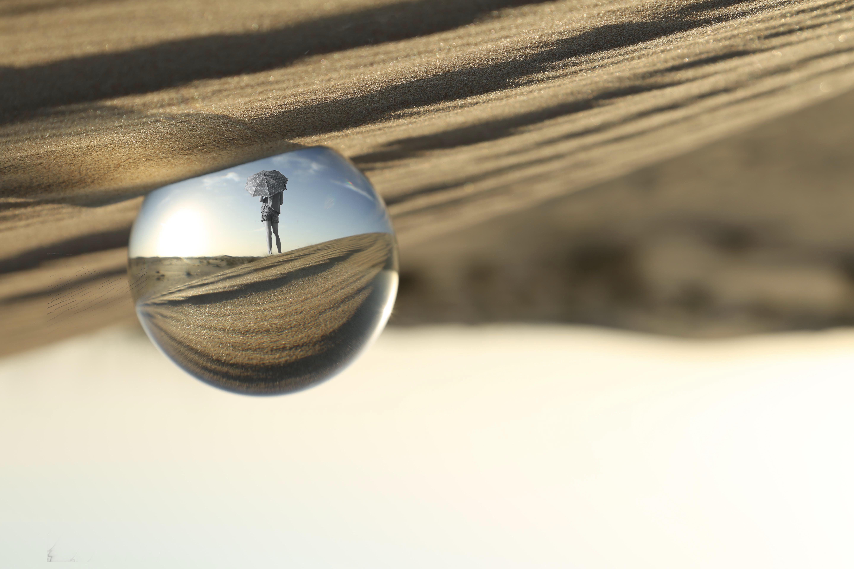Snow Globe on Brown Sand