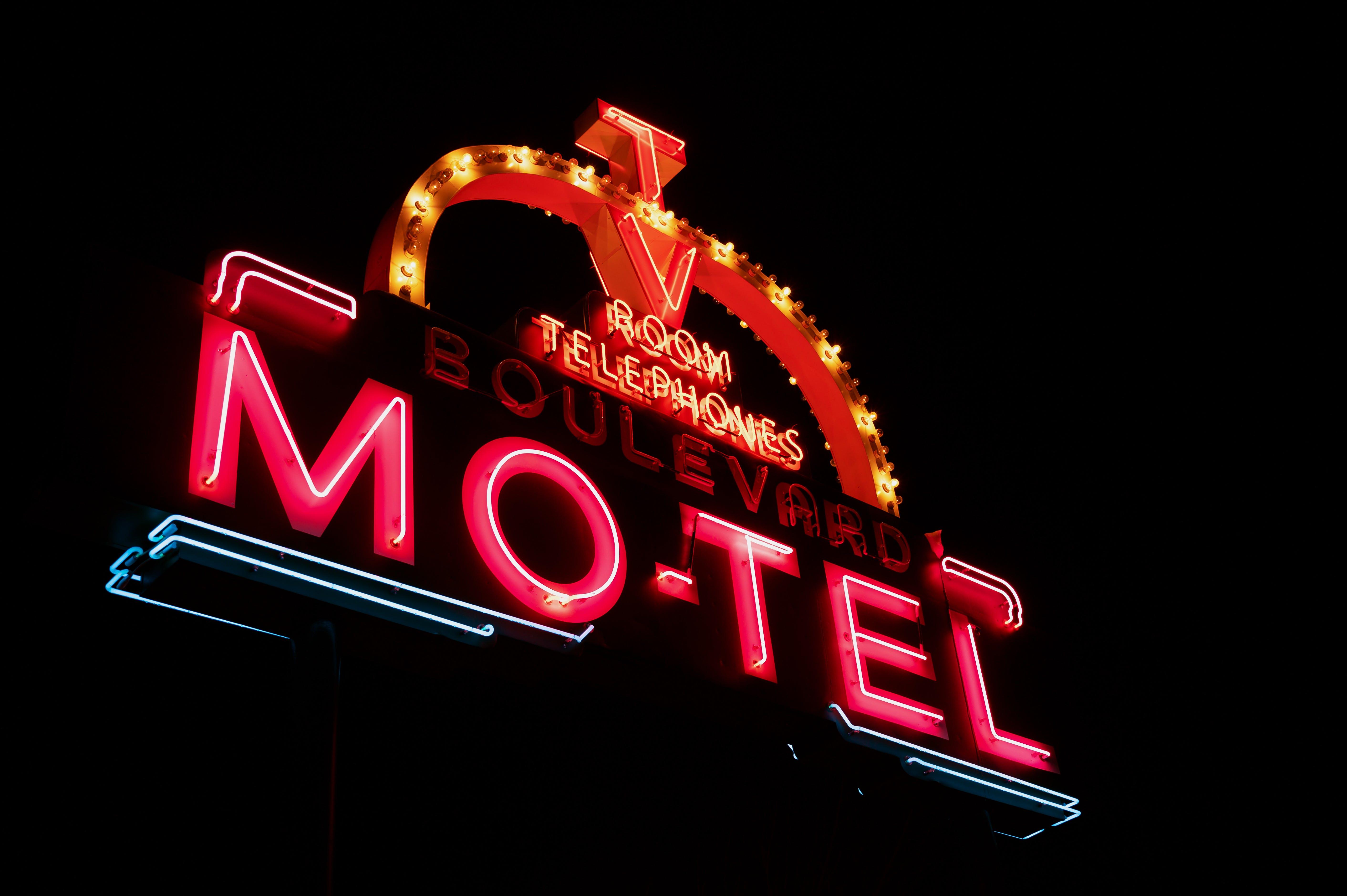 Photo of Red and Orange Motel Neon Signage