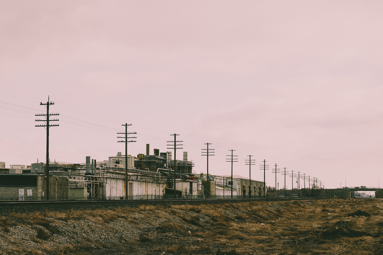 Line of Electric Post Near Concrete Building