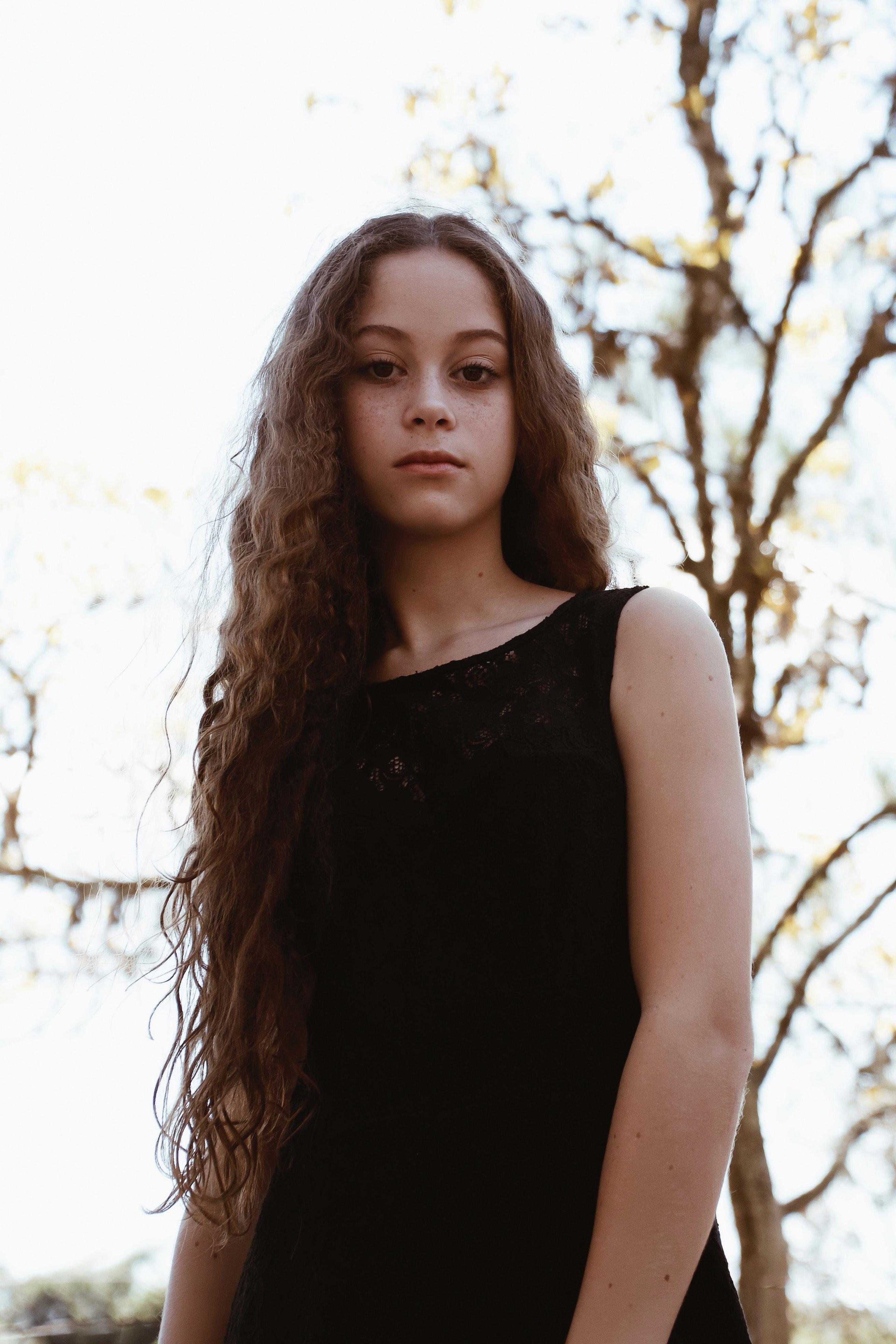812cbf66bba Woman Wearing Black Boat-neck Sleeveless Dress · Free Stock Photo