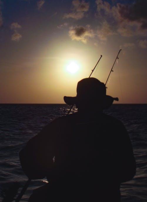 Бесплатное стоковое фото с вечернее солнце, на берегу моря, океан, рыбалка