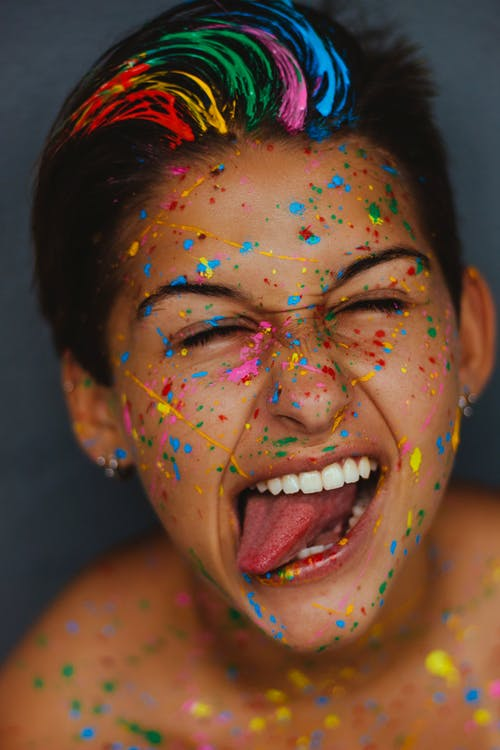 Woman's Face With Color Splatters