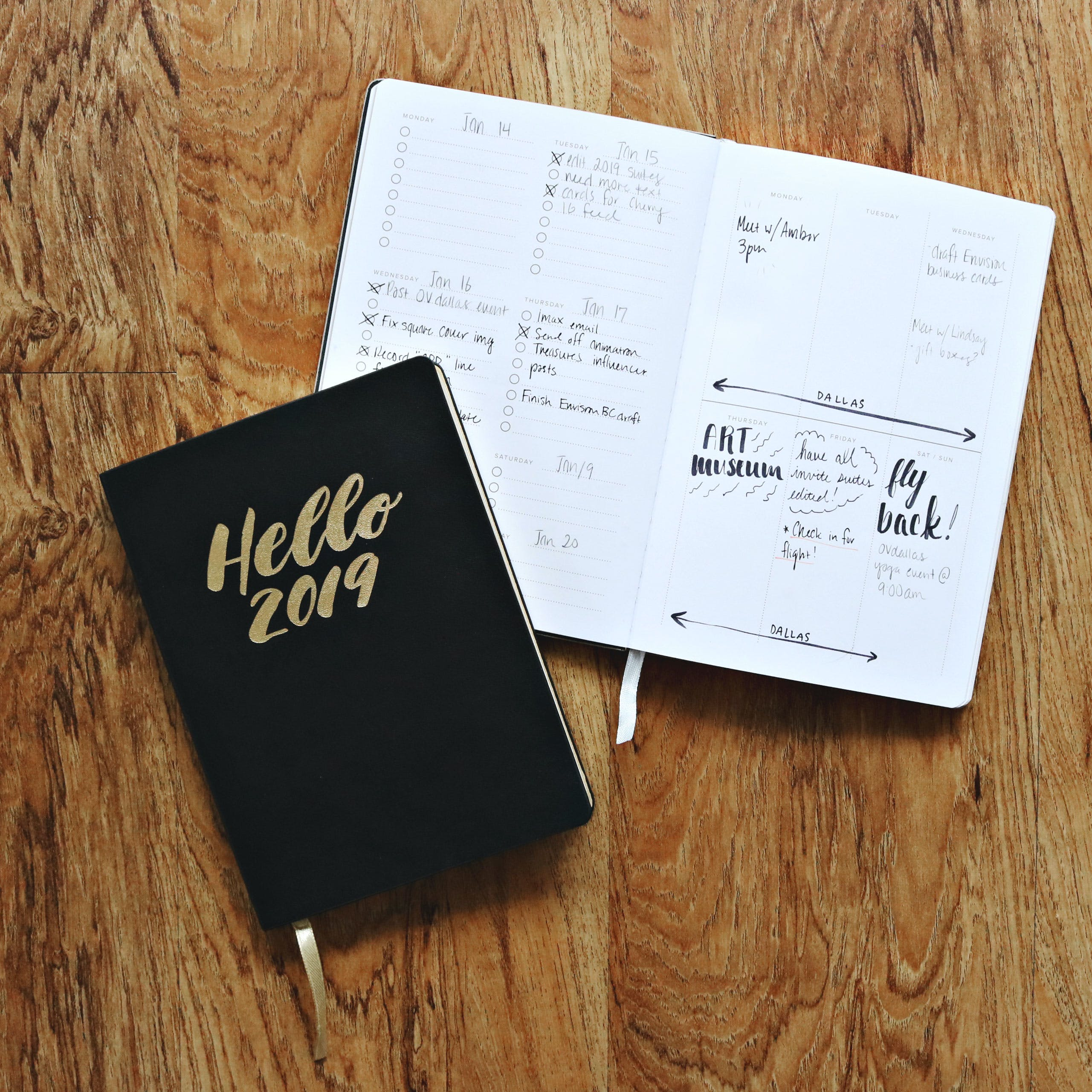 Black Hello 2019 Notebook on Brown Wooden Surface