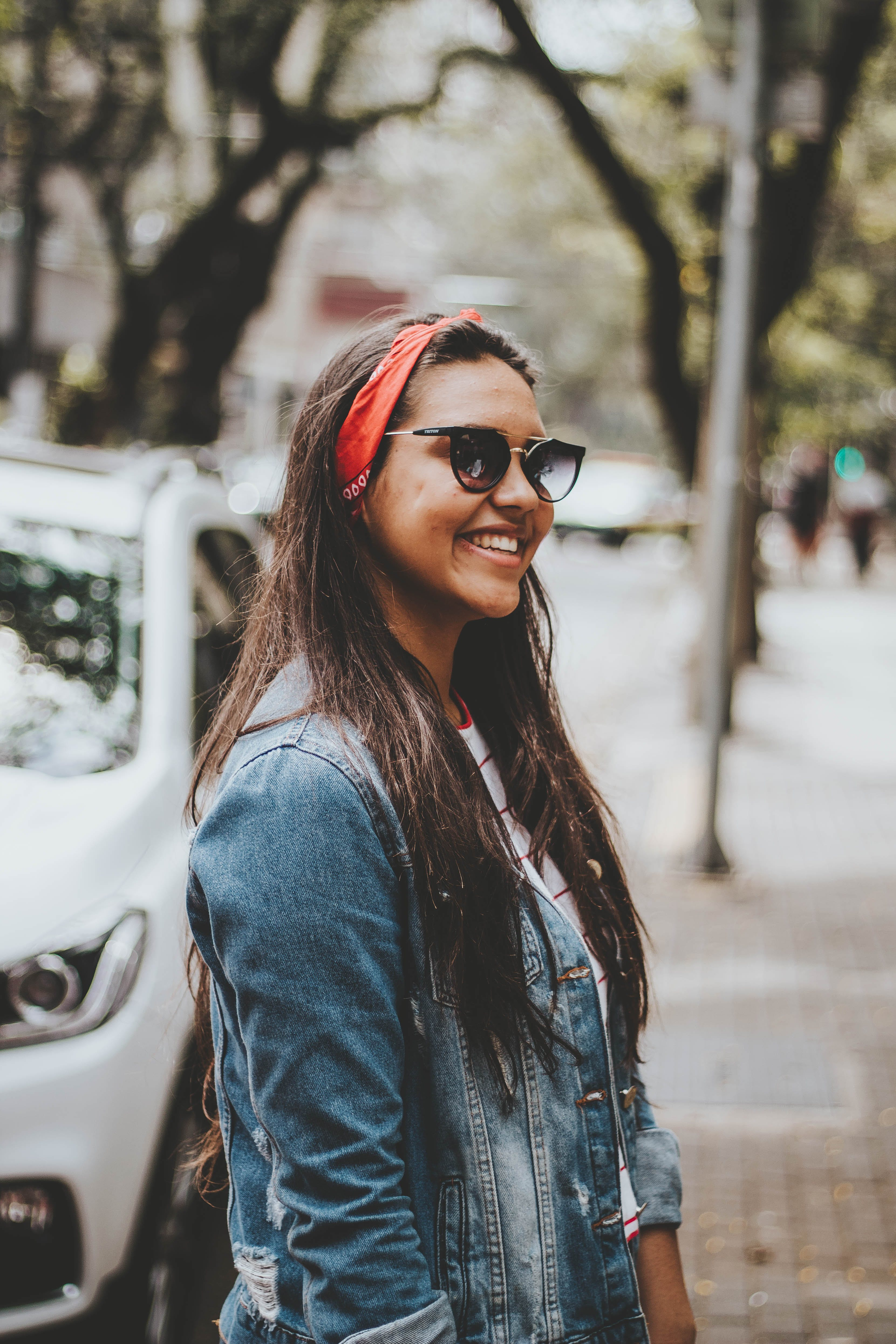 Woman Smiling Near White Suv Parked