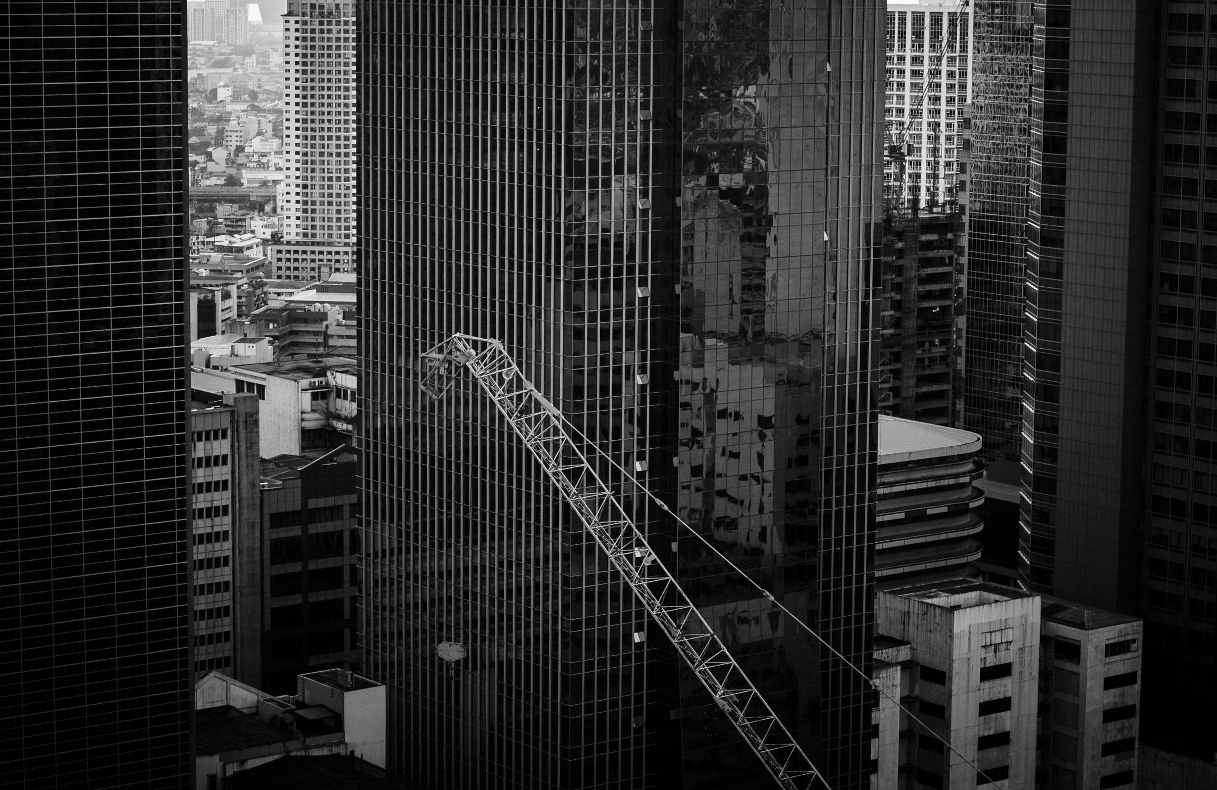 Grayscale Photo of a High Rise Building