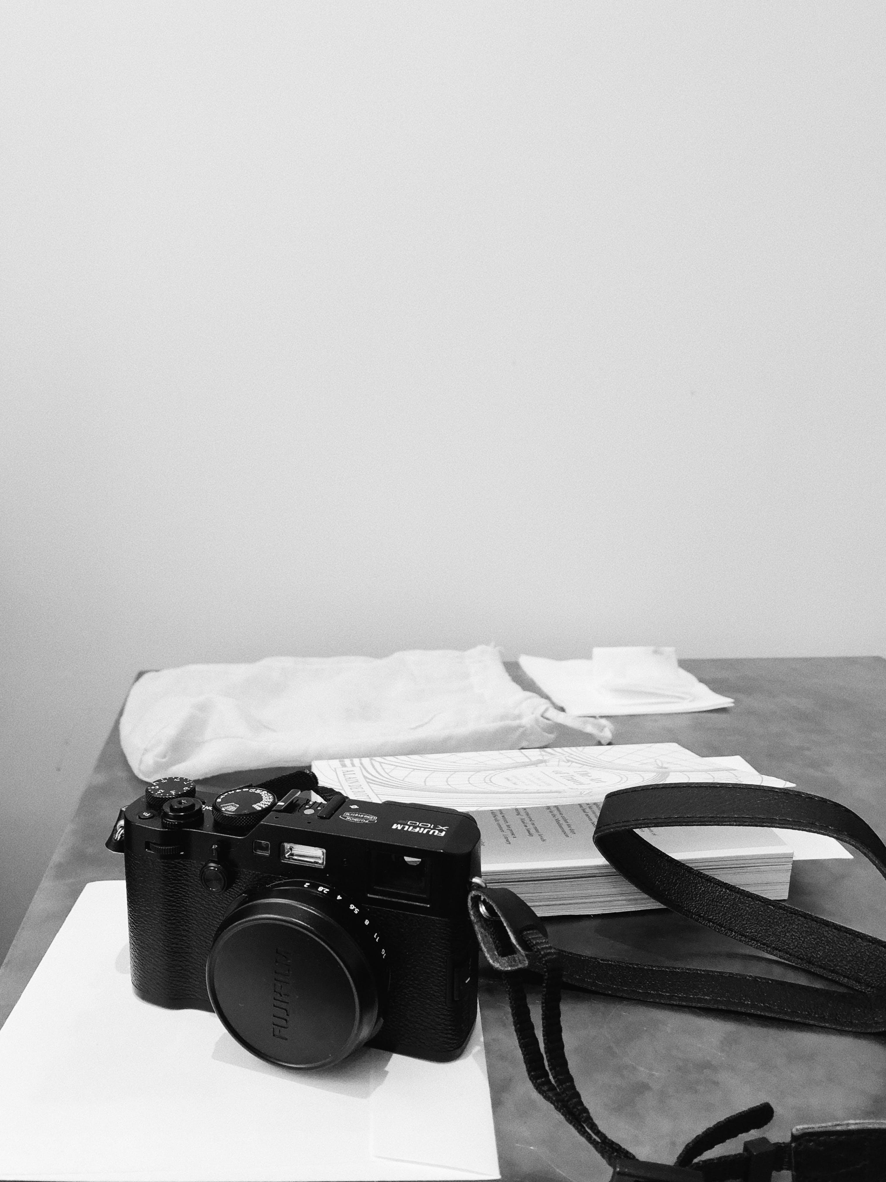 Black Slr Camera on Table