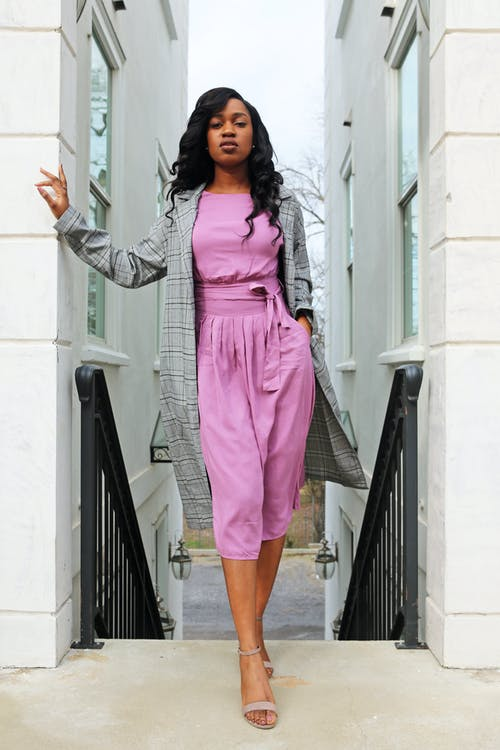 Woman In Pink Rompers And Grey Coat