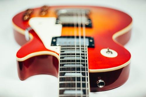 Brown and Orange Electric Guitar
