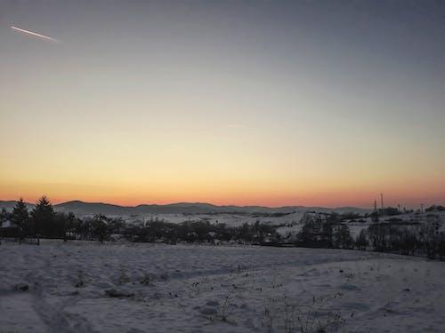 Foto stok gratis cakrawala emas, kapal terbang, matahari terbenam, musim dingin