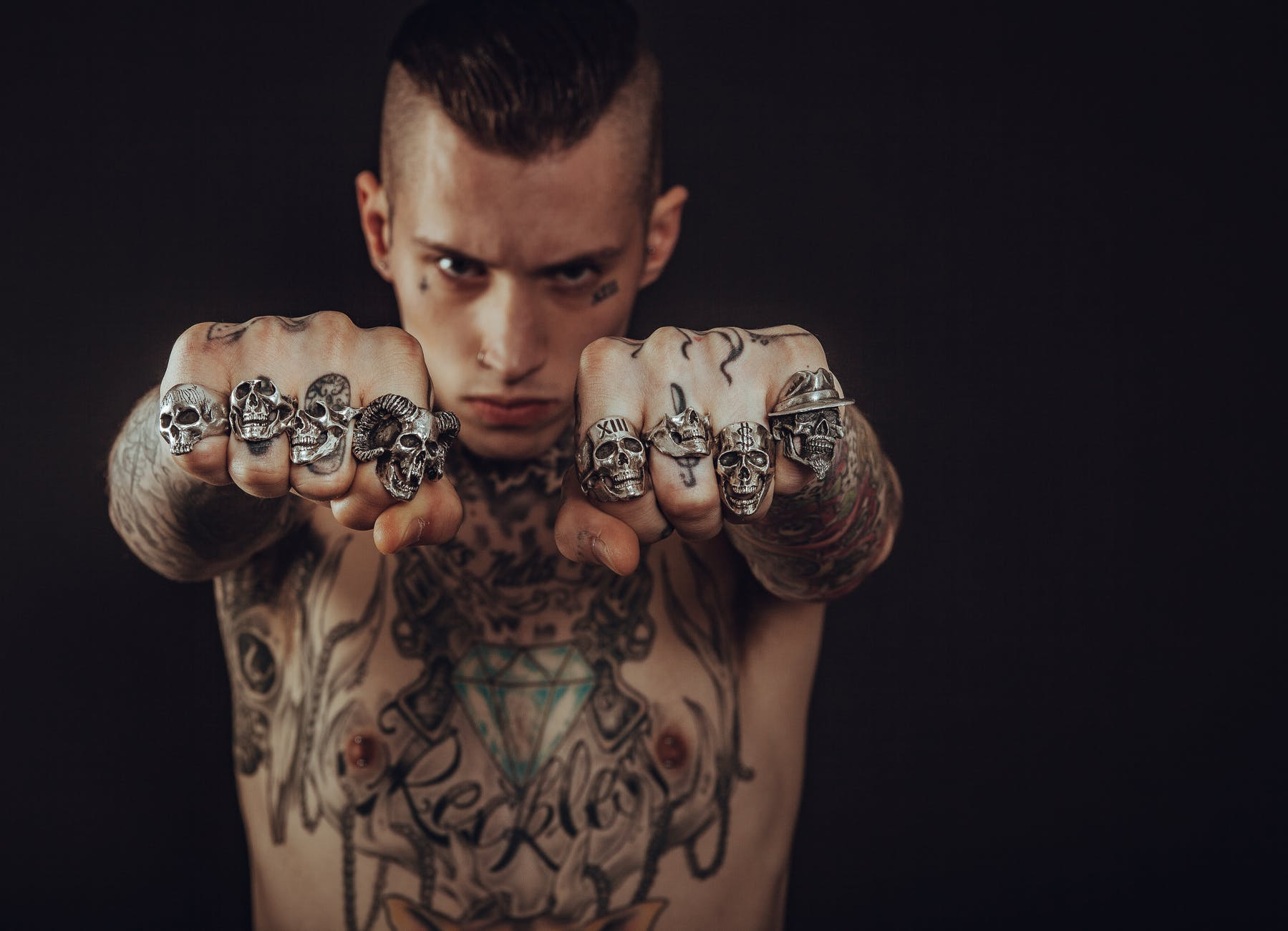 realistic tattoos of skulls in hands and upper body part