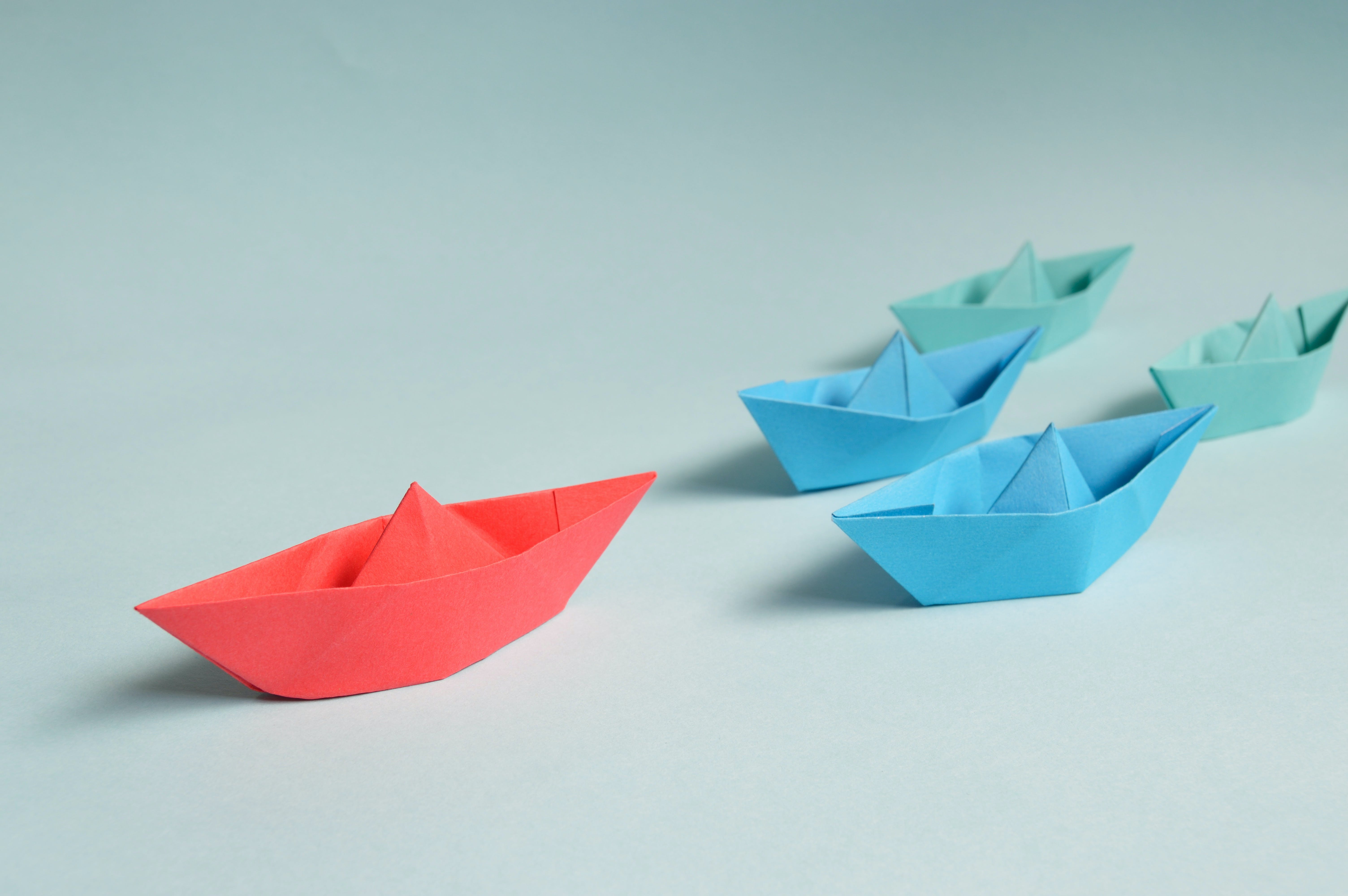 Paper Boats on Solid Surface