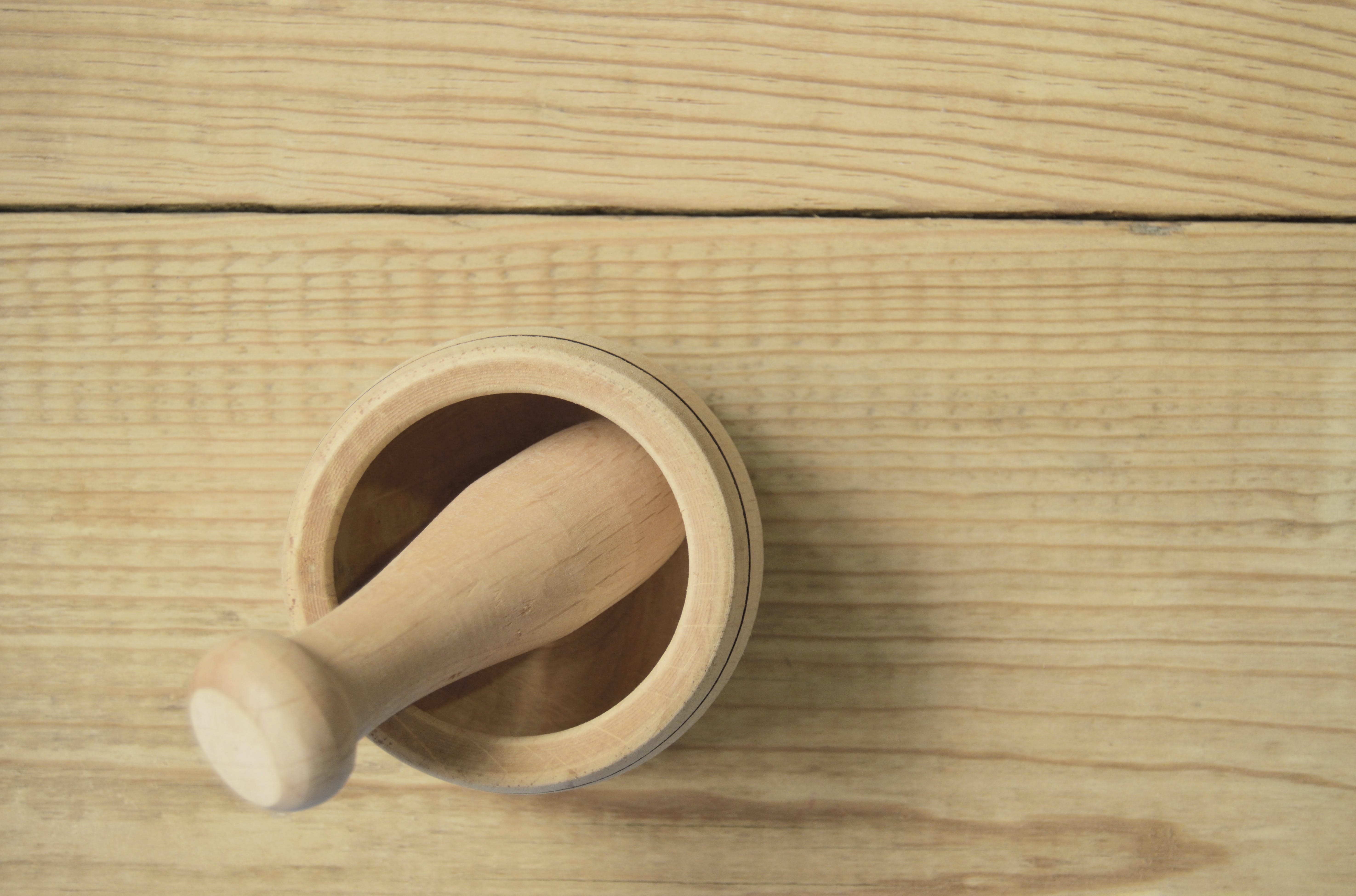 Brown Wooden Pestle and Mortar