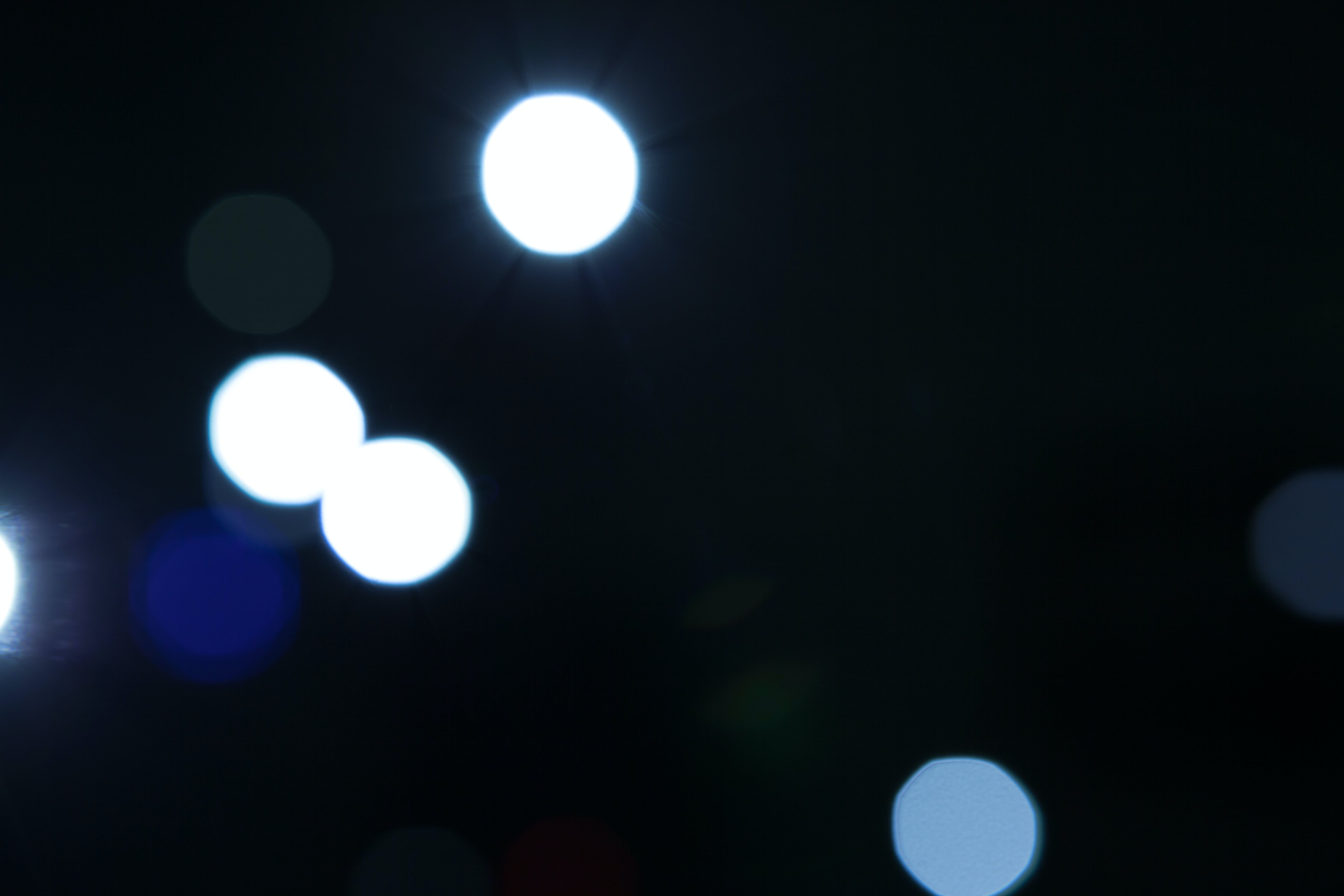 Bokeh Photography of Blue and White Lights