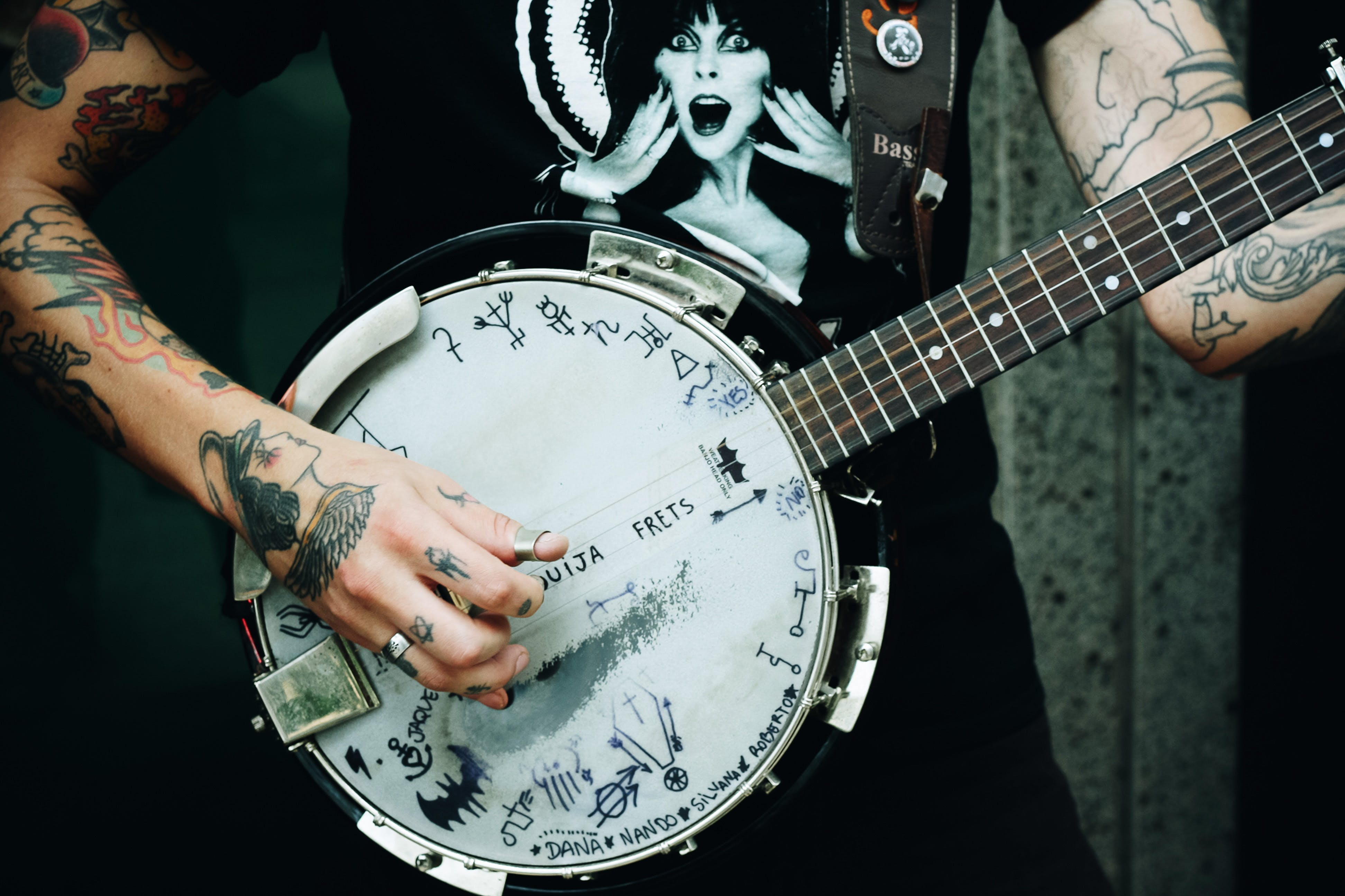 Person Holding Banjo